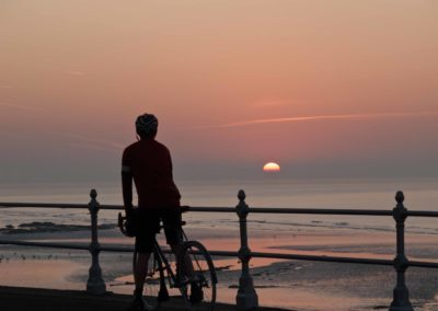 Red sun in the morning; I witness nearly every sunrise from the saddle of my bicycle