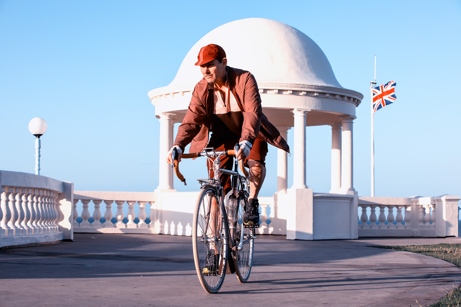 Recreating the sense of one of those upbeat 1950s advertisement for made-in-Britain bicycles; image tae at the King George V Colonnade on the seafront at Bexhill-on-Sea