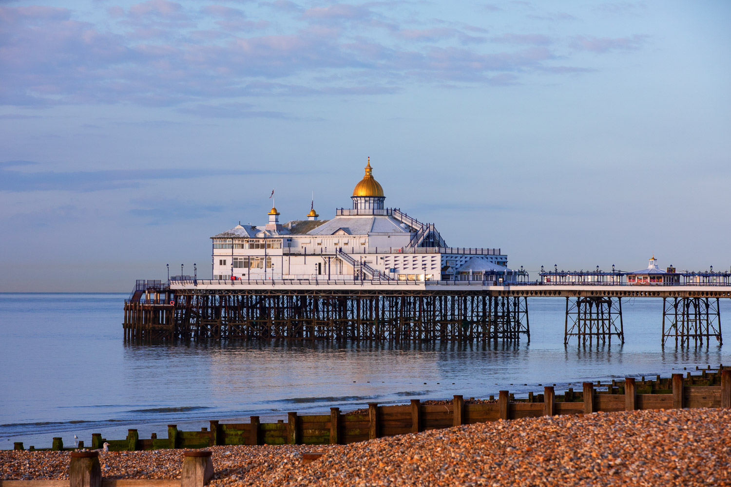 Eastbourne Pier looking lie a confection in a soft morning light. The Victorian-era fun pier was opened  1870 and designed by Eugenius Birch