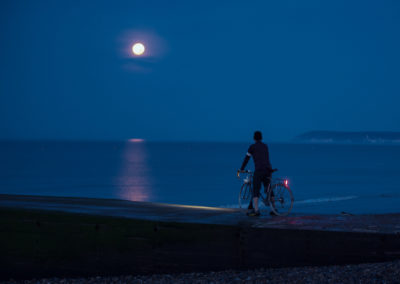 A full moon shimmers on the sea on an early morning ride through Bexhill