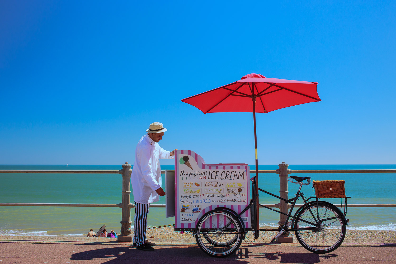 Stop Me And Buy One - a gelato vendor sets up for business on the seafront promenade at Hastings.