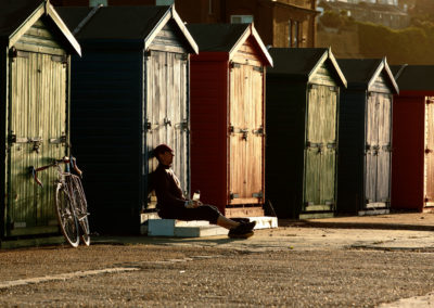 Watching the sunrise by the beach huts on the seafront at St Leonards