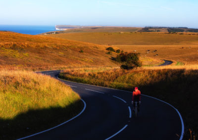 A long ride into morning. Sunrise on the Sussex Downs, near Beachy Head