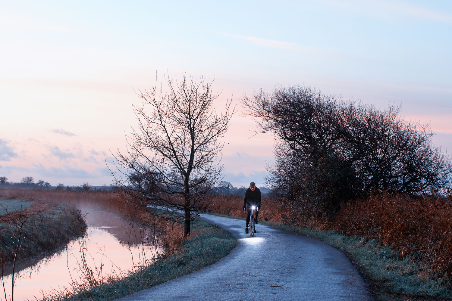 Dawn light - Cycling in Sussex along a country lane in the mashes near Rickney