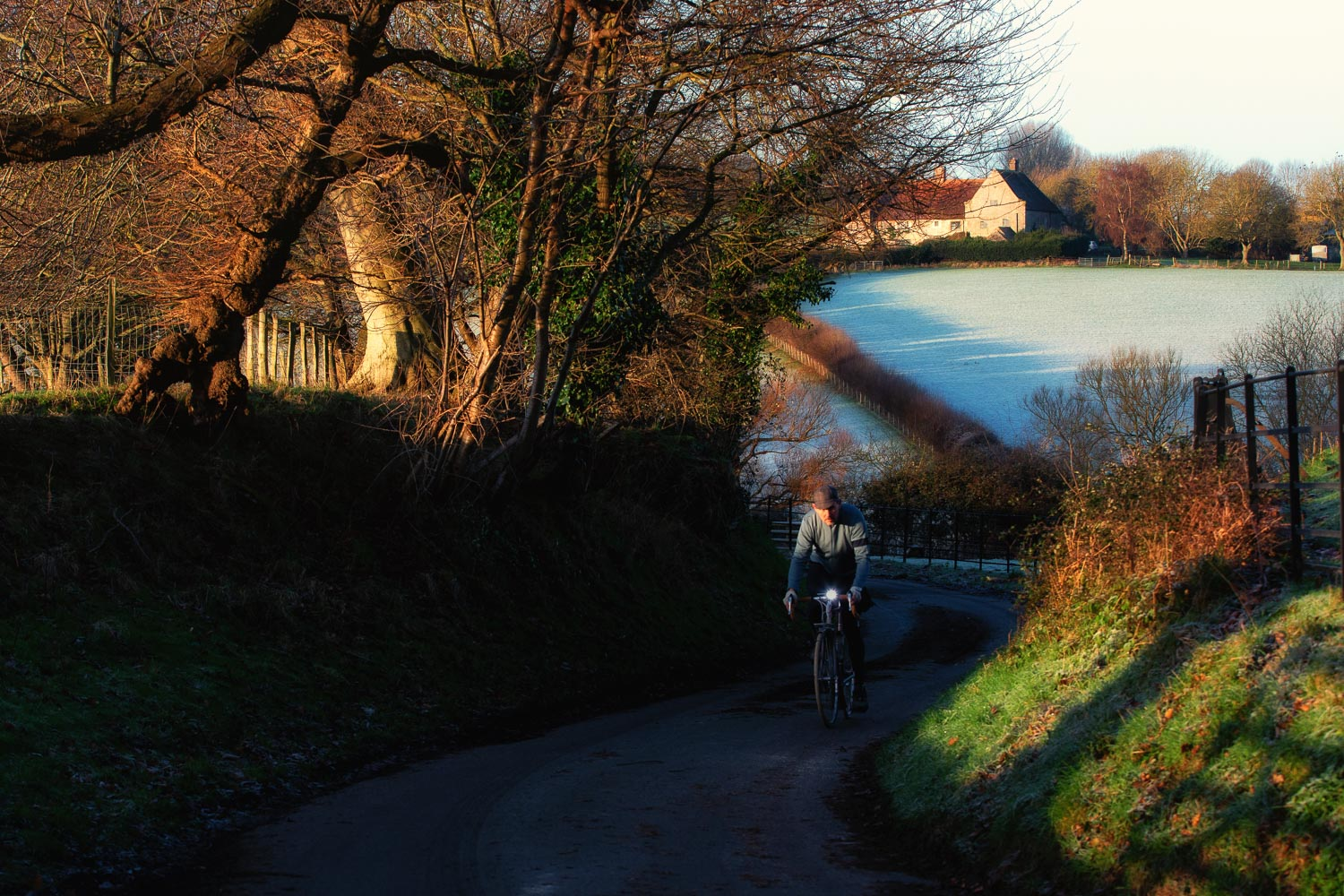 Cycling in along a country lane in Sussex at sunrise on a frosty morning